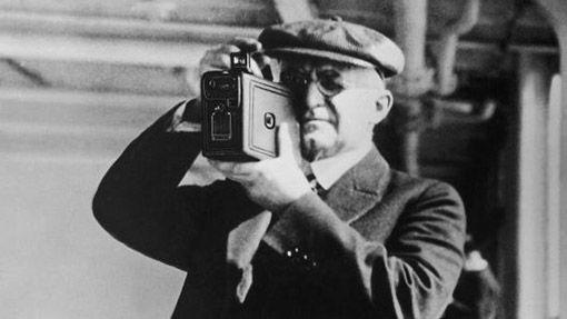 Джордж Истмен с камерой Kodak