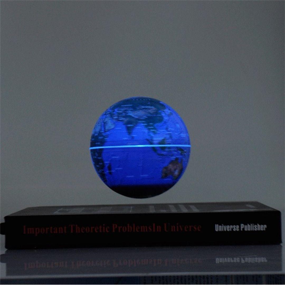 Левитирующий глобус над книгой